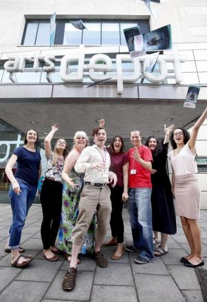 Tim Burley, development director at artsdepot, celebrates cash boost with colleagues outside the arts centre.