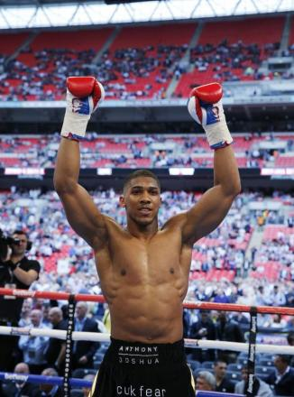 Anthony Joshua celebrates victory over Matt Legg at Wembley. Picture: Action Images