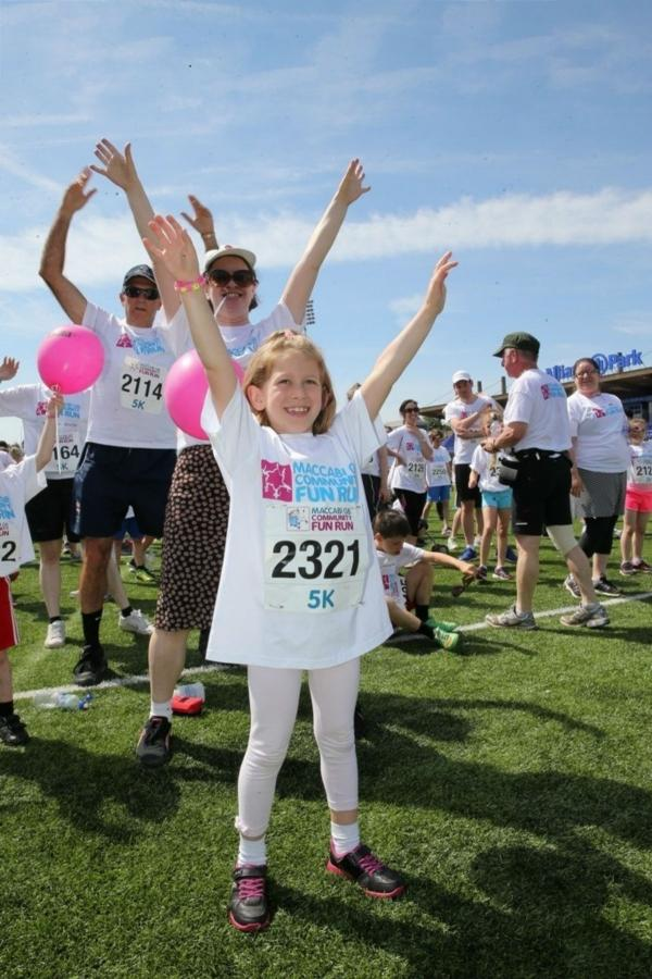 Ruby Weissbart, age seven, warming up for the fun run