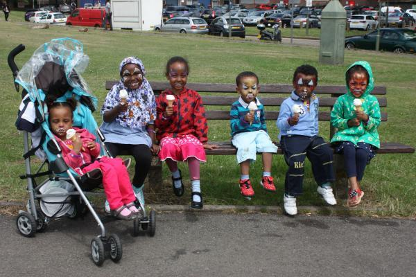 Times Series: Children enjoy an ice-cream after having their faces painted
