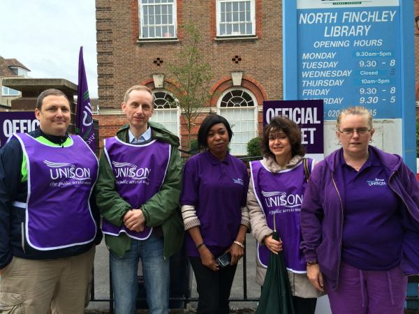 North Finchley library worker Cathy  Yilmaz, (far right) is joined by fellow public sector workers outside North Finchley Library this morning