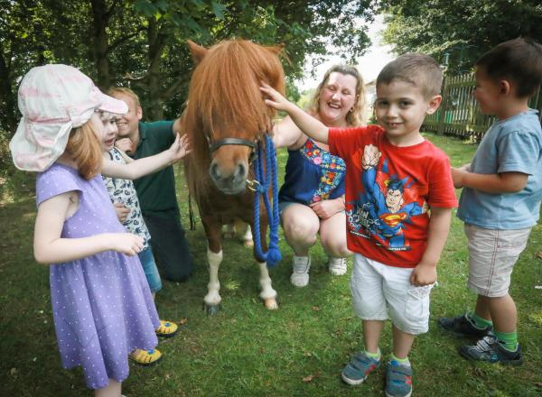 Pony meets children for end of term treat