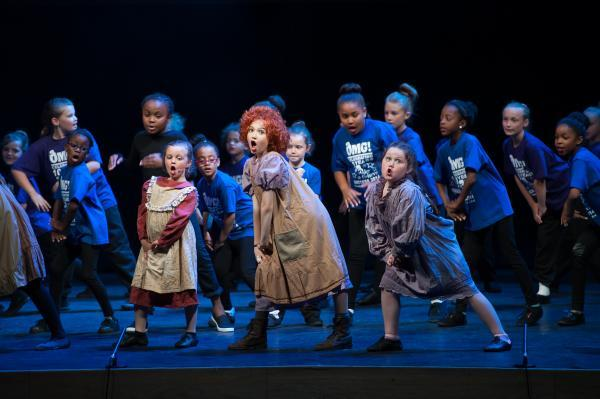 Children perform on West End stage