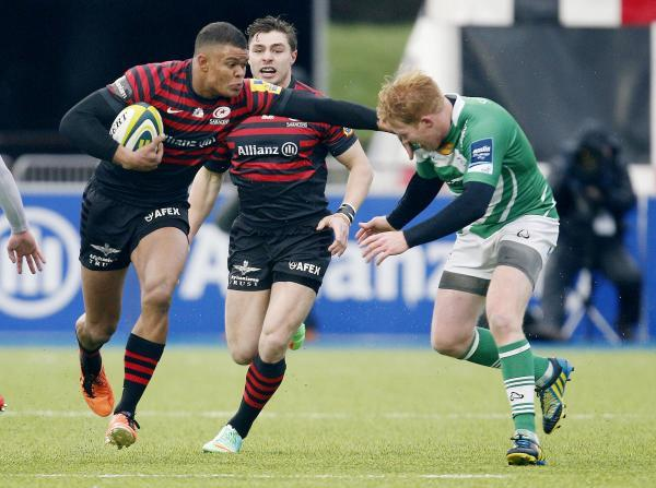 Saracens' Nathan Earle (far left) score the try of the game. Picture: Action Images