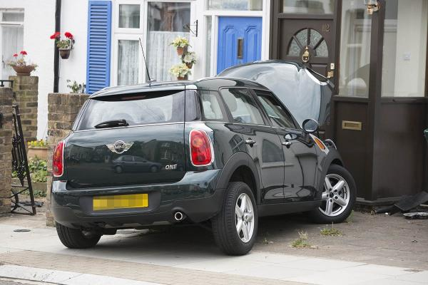 Grandfather's car spins out of control and crashes into front of house