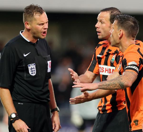 Sam Togwell (centre) remonstrates with the referee. Picture: Dave Peters