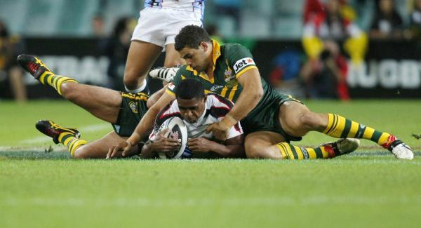 Wes Naiqama (left) is tackled during Fiji's 2008 World Cup semi-final against Australia. Picture: Action Images