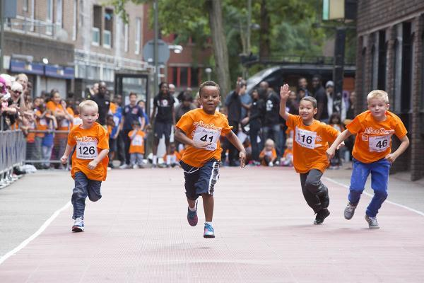 Children sprint to the finish line at sports event