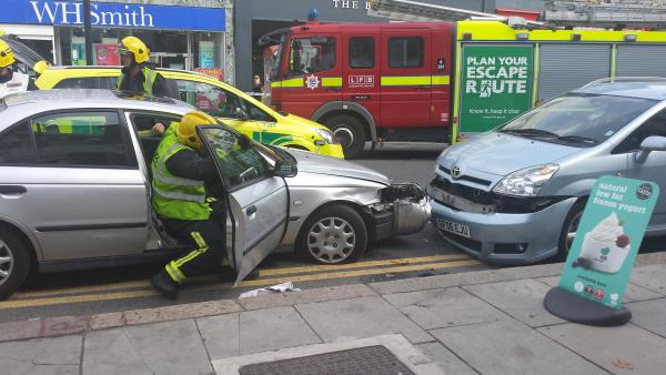Man pinned between two cars after breaking down