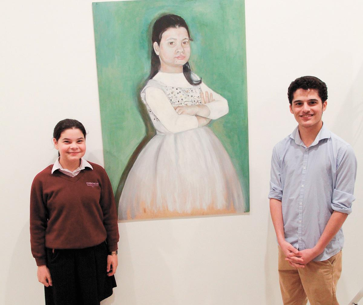 Chani and Shemi with the award-winning painting