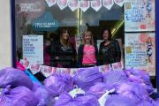 Super slimmers donate old clothes to cancer charity