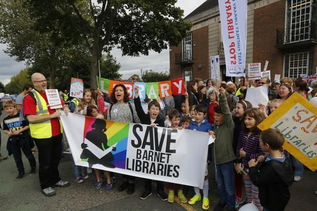 Save Barnet Libraries held several marches last year over the cuts. Pictured: Campaigners outside East Finchley Library