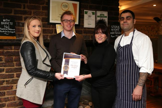Owner Nick Bottrill, supervisor Jo Keating and head chef Lionel Mendes receive the award from the Times Series' Lauren Booker