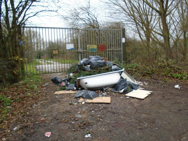 The bath, toilet and wooden sign were dumped in Drop Lane