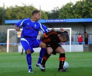 Wingate & Finchley, in blue, do battle against Barnet