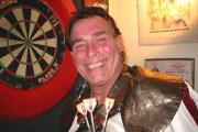 The charismatic 'King of Bling' will play ten legs of darts at an exhibition match - including some against lucky members of the crowd