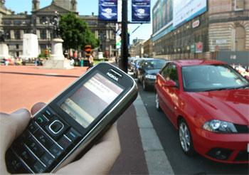 Motorists will have to pay for parking using using mobile phones or pre-paid scratch cards