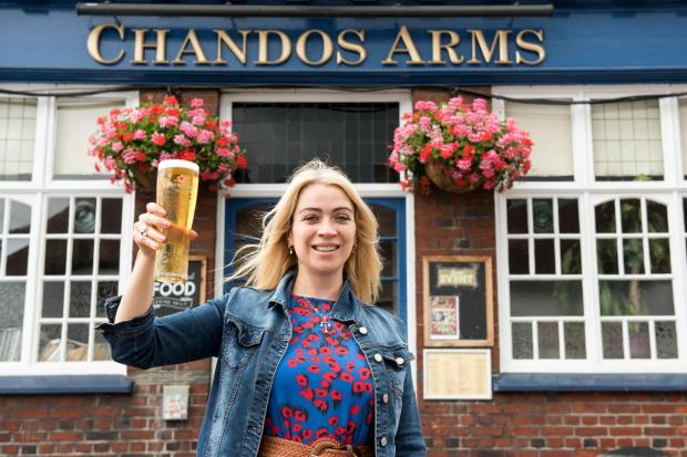 Times Series: Emily Kolltveit, landlady of Chandos Arms, outside the pub in Colindale Avenue