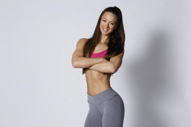 Personal trainer and WBFF Pro Nicole Aristides creating a