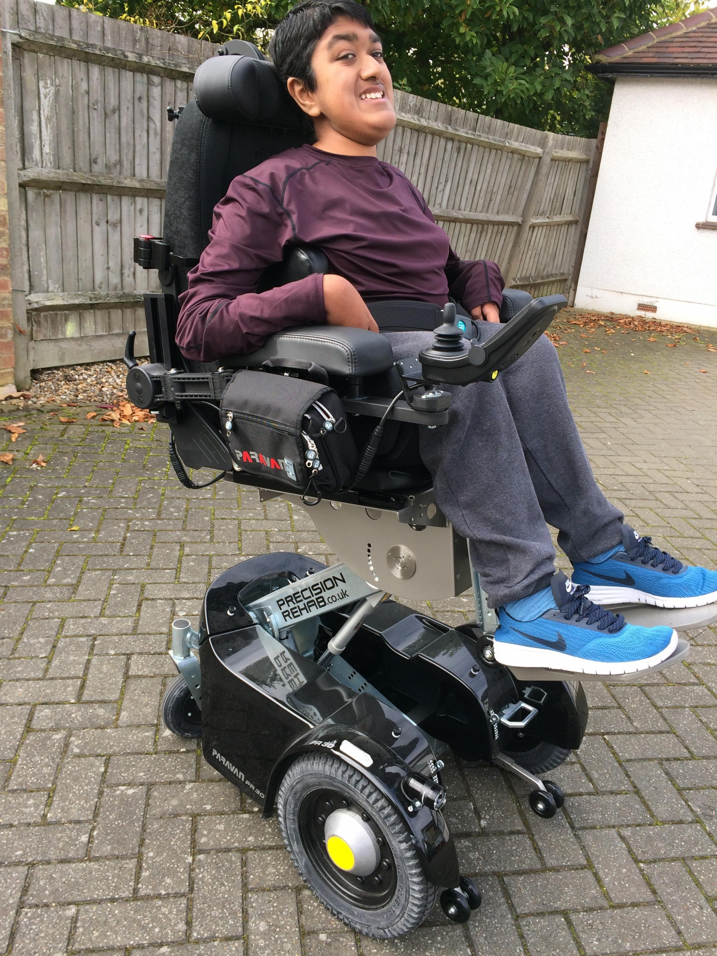 Kai Shah, 14, in his new powered wheelchair from Newlife charity