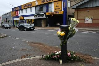 Flowers have been left at the scene of the incident in High Street, Edgware