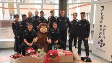 Young Middlesex cricketers giving gifts to children at Barnet Hospital