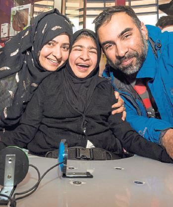 Maleeha Malik, 14, with mum Saba and dad Javvad with hernew powered wheelchair (Photo: Colin Bridges)