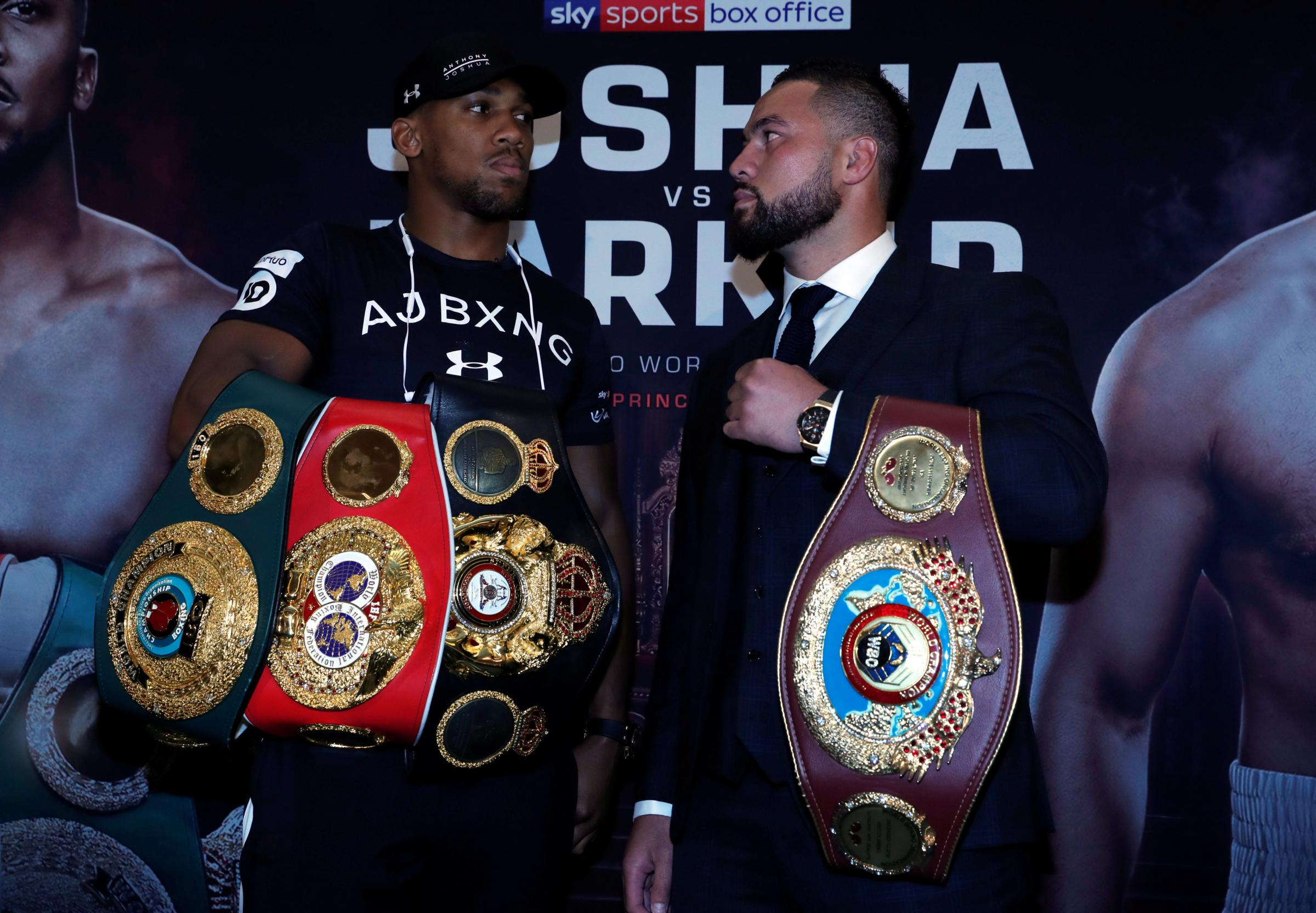 Belts on the line: Anthony Joshua and Joseph Parker at today's press conference. Picture: Action Images