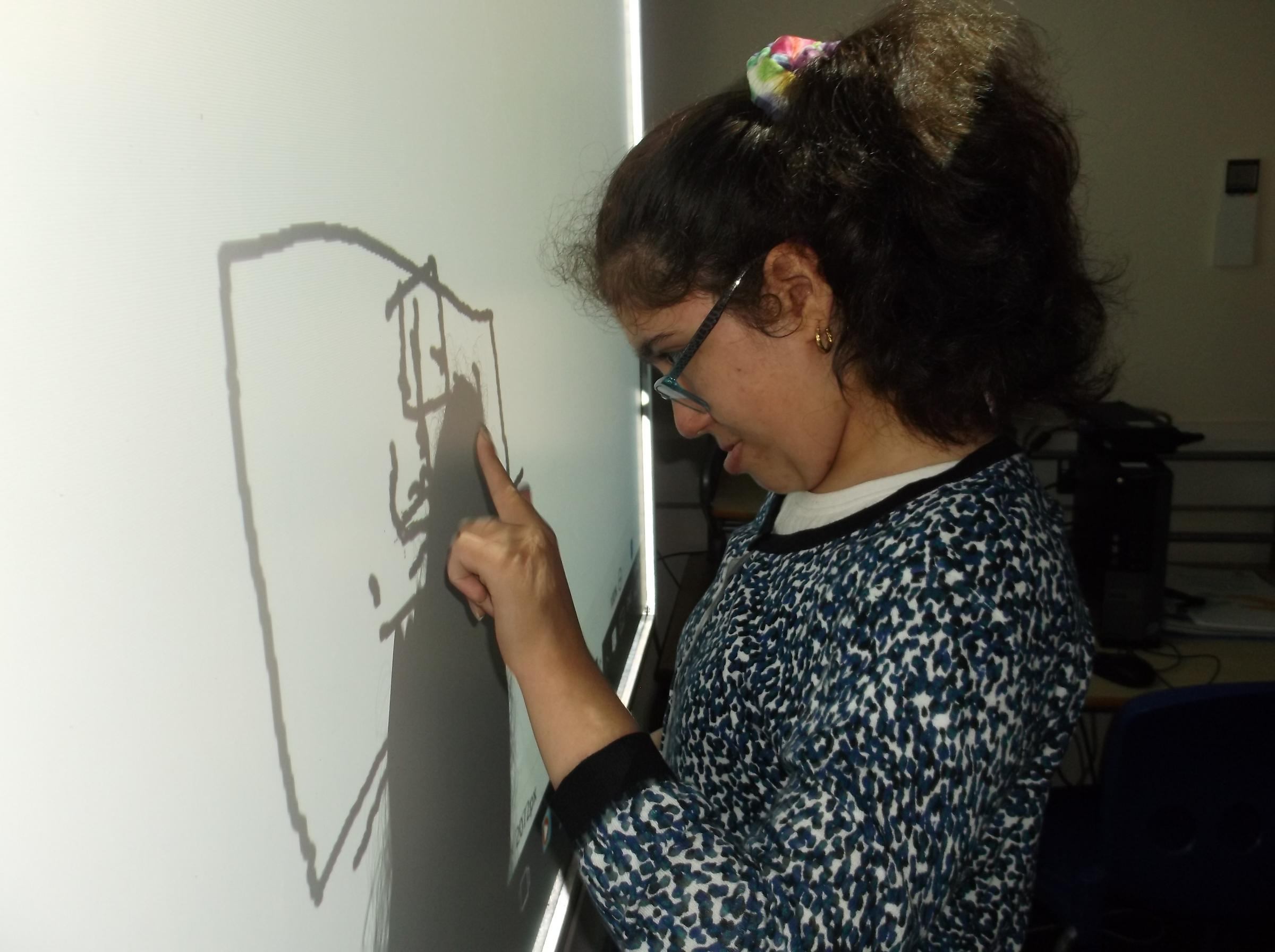 Manhoor, one of the artists, preparing her work for the exhibition