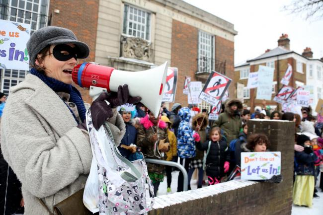 Children and parents protested in the snowy weather for more access to libraries (Photo: Holly Cant)