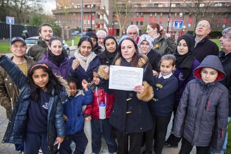 Shona Perkins holding petition with Strawberry Vale residents during the problems in 2016