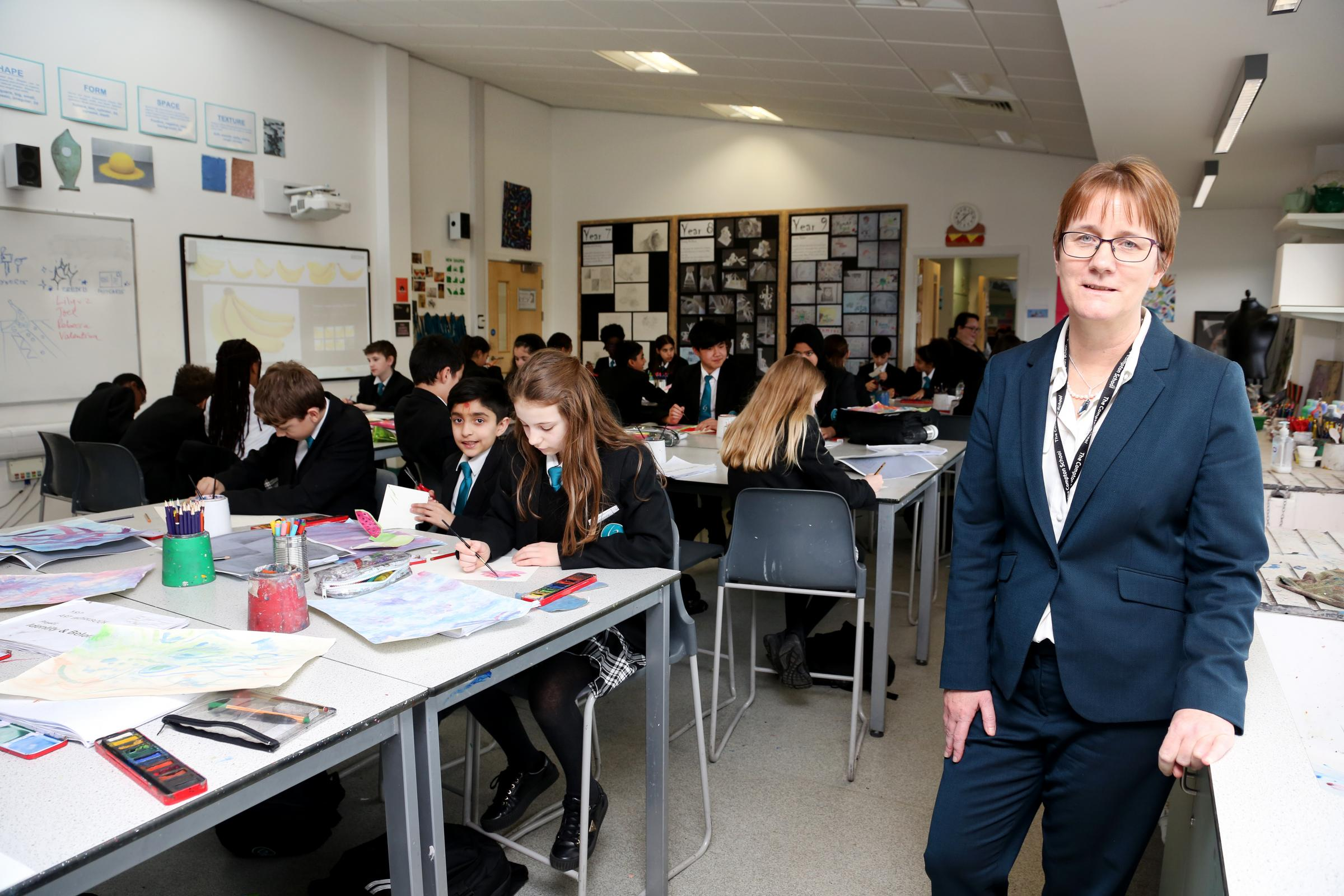 The Compton School headteacher Ann Marie Mulkerins with pupils at the school (Photo: Holly Cant)