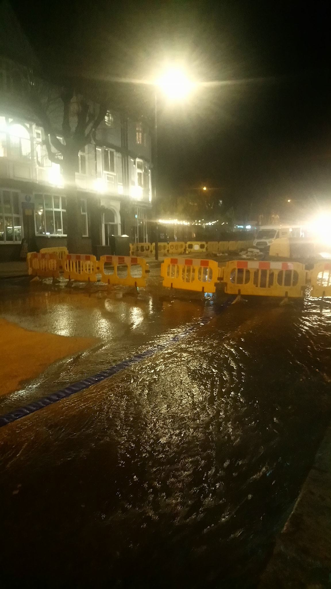 A burst water main flooded a high street over the weekend closing part of the road.