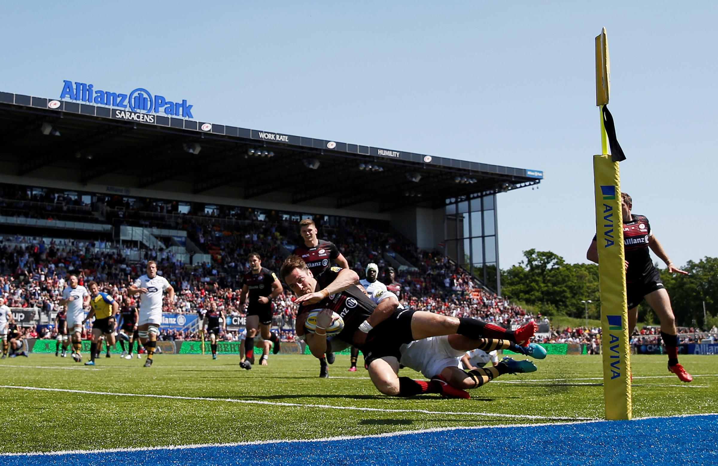 Chris Wyles dives over to score for Saracens. Picture: Action Images