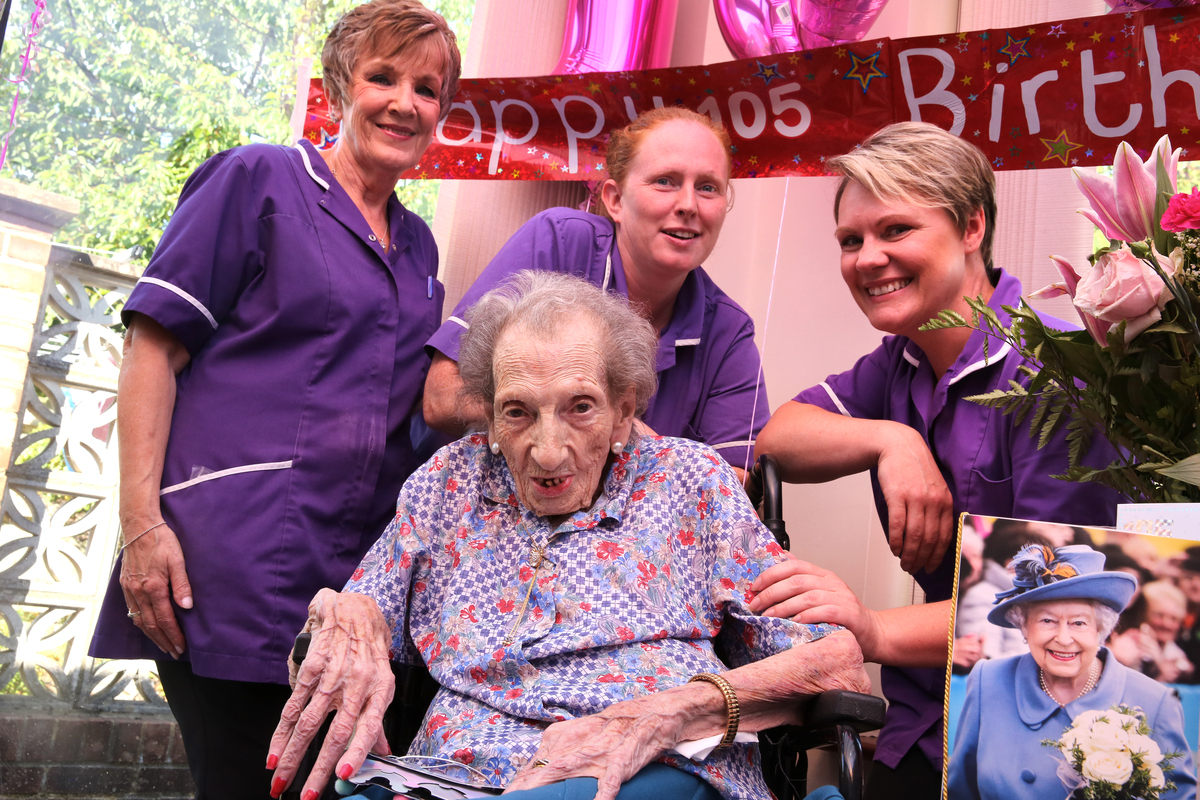 Gwendoline Hardy celebrates her 105th birthday with staff LynMcCarty, Sinead Patten, and Joanna Wolak
