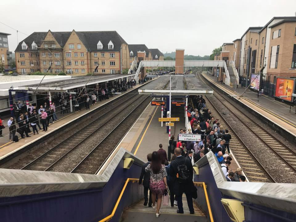 Passengers at Elstree & Borehamwood station wait on the platform amid cancelled trains.