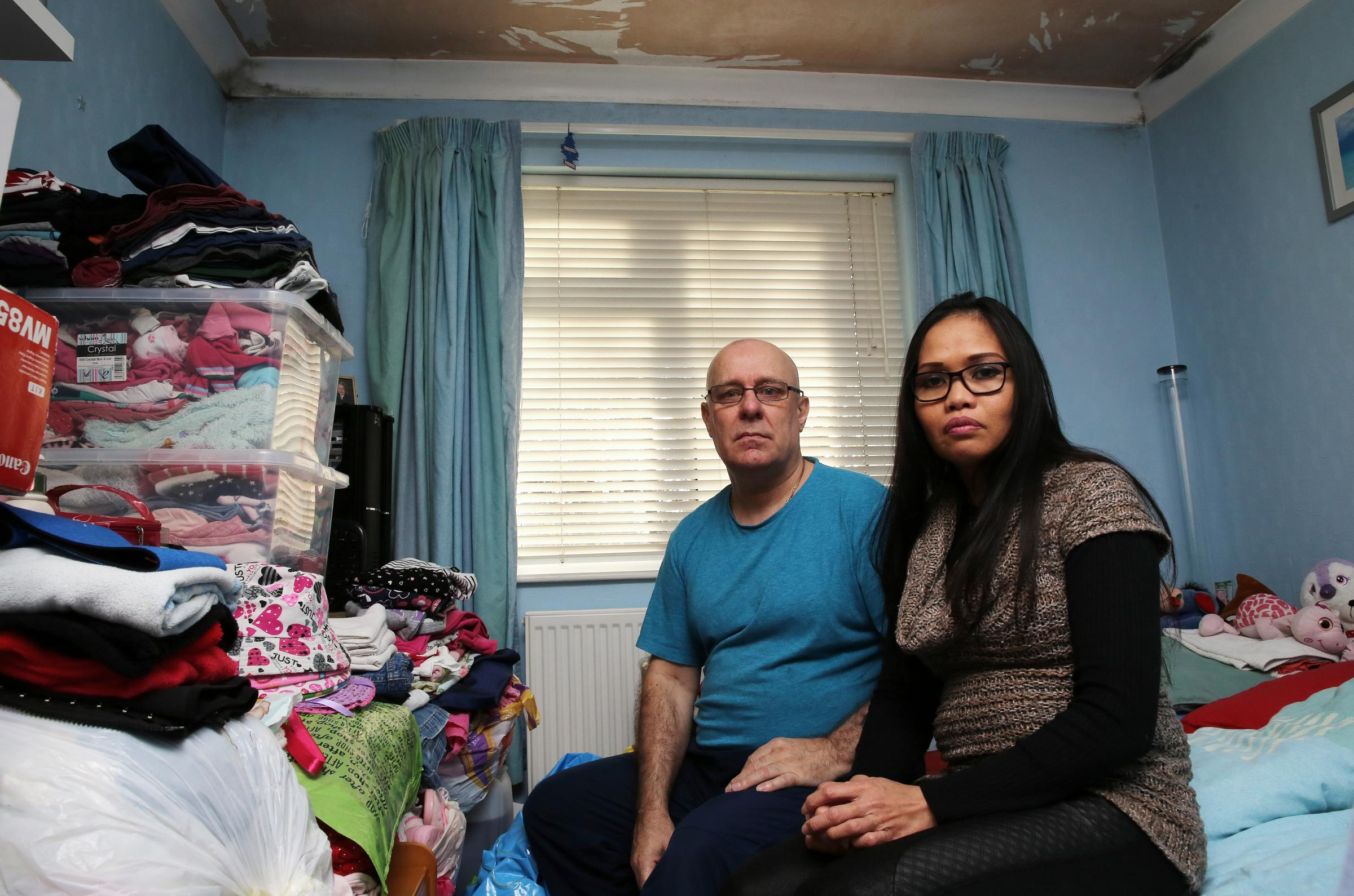 Neil Reed and wife Rosario in their cramped flat