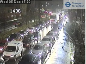 One lane on the the A406 eastbound is blocked and traffic is backed up