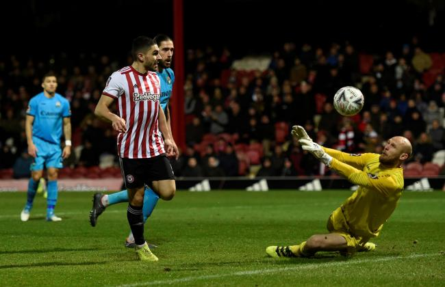Mark Cousins denies Neal Maupay. Picture: Action Images