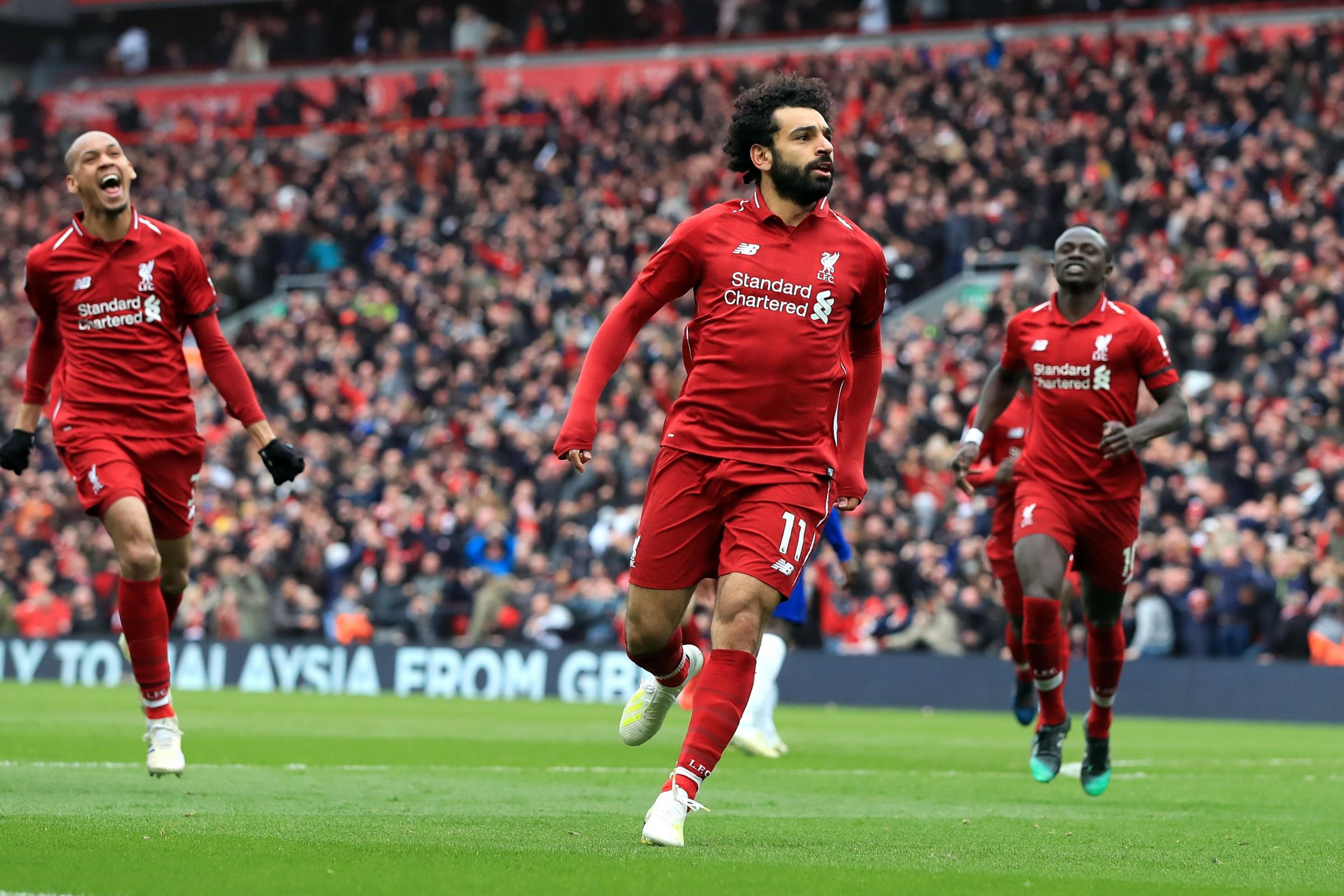Mohamed Salah, centre, starred in Liverpool's win over Chelsea (Peter Byrne/PA)