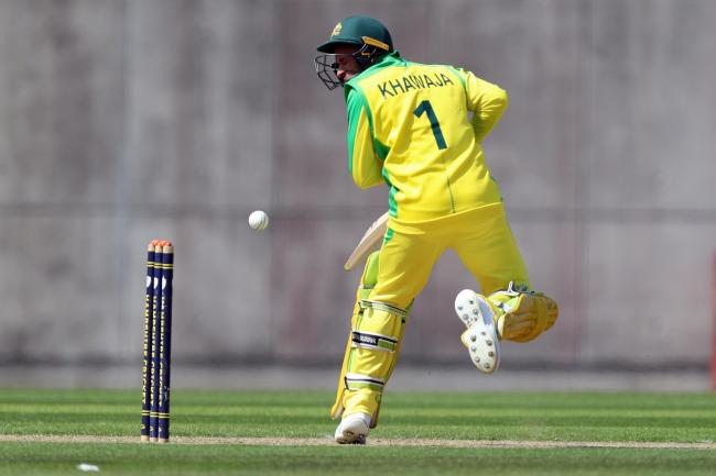 Australia's Usman Khawaja was struck on the jaw by an Andre Russell delivery
