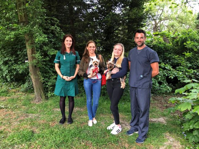 Medivet Hendon Veterinary nurse Sasha Potter, owner Justyna Fischer (with Bambi), Justyna's daughter Nicole (with Zuza) and Medivet Hendon branch partner and vet Jerry Dunne.